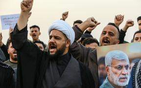03 January 2020, Iraq, Baghdad: Supporters of the predominantly Shia Muslim Popular Mobilization Forces (PMF) shout slogans during an anti-US protest after the US airstrike in Baghdad that killed Qassem Soleimani,