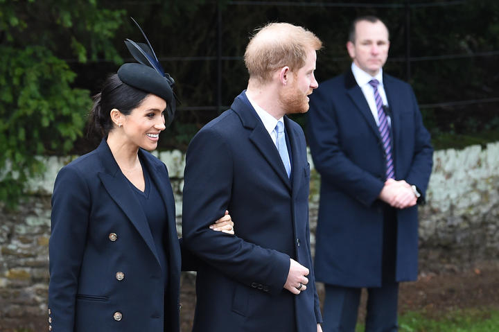 Meghan, Duchess of Sussex and Britain's Prince Harry, Duke of Sussex, depart after the Royal Family's traditional Christmas Day service at St Mary Magdalene Church in Sandringham, Norfolk, eastern England, on December 25, 2018.