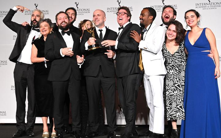 "Writer Fabio Porchat, (C), poses with the ""Especial de Natal Porta dos Fundos,"" crew in celebration of their best comedy award during the 2019 International Emmy Awards Gala on November 25, 2019 in New York City."
