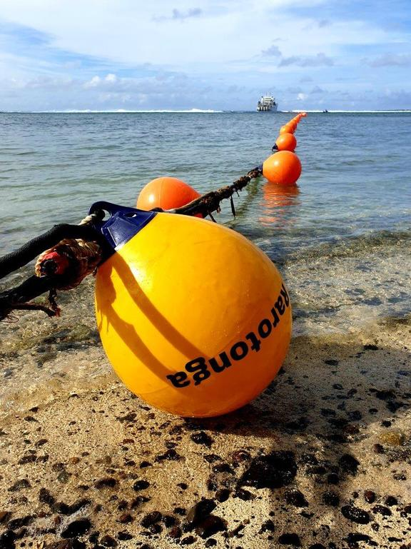 The first cable buoy reaching land in Rutaki, Rarotonga, Cook Islands.