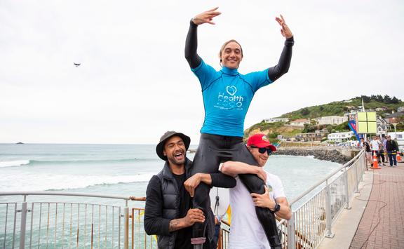 Elliot Paerata-Reid celebrates his win in the Open Men's final at the 2020 NZ Surfing Championships at St Clair, Dunedin.