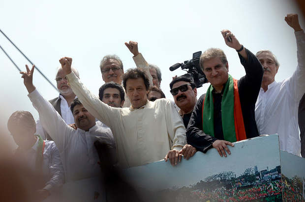 Pakistan cricketer-turned-politician Imran Khan (C) gestures as he heads a protest march from Lahore to Islamabad.