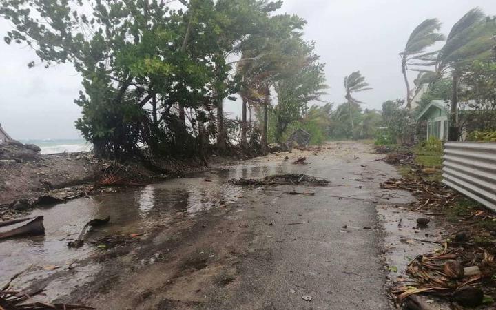 Debris across the one main road on Tuvalu's main atoll, Funafuti.