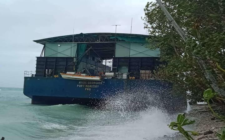 A barge that was moored in Funafuti lagoon was shunted onto the beach by Cyclone Tino.