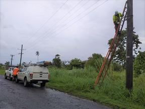 Linesmen repair damage caused by Cyclone Tino