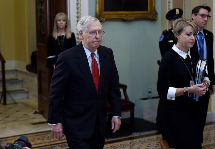 Senate Majority Leader Mitch McConnell leaves the Senate Chamber during the first day of US President Donald Trump's impeachment trial in the Senate, January 21, 2020.