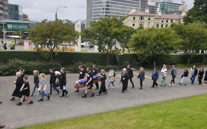 A mock funeral led by Julian and Camilla Cox who cycled from Dunedin to Wellington. Pictured outside Parliament.