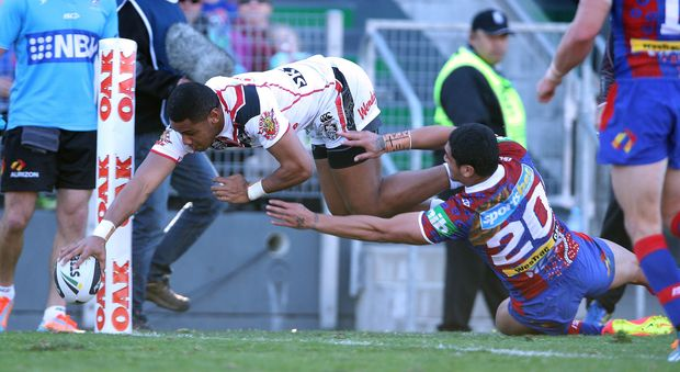 Warriors winger David Fusitua scores against Newcastle.