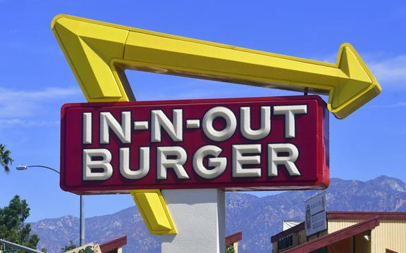 The signs points to an In-N-Out Burger restaurant in Alhambra, California on August 30, 2018.