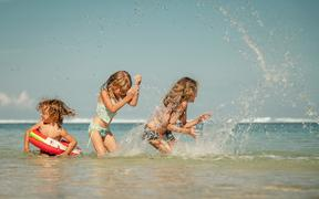 Happy kids playing on the beach at the day time - weather, heat, hot, summer, sun