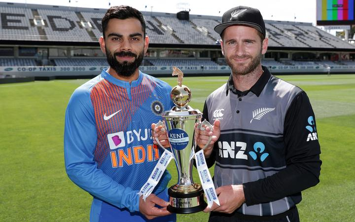 Black Caps captain Kane Williamson and Indian skipper Virat Kohli with the trophy for their T20 series in New Zealand.