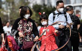 Chinese citizens wear masks in an attempt to protect themselves against the coronavirus.