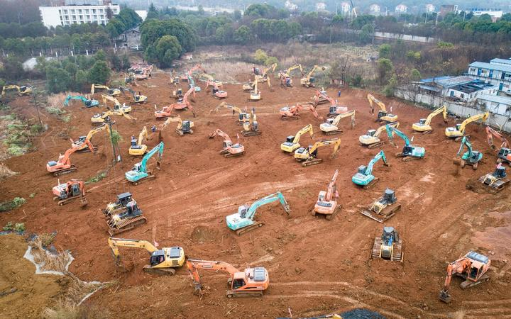 Mechanical equipment working at the construction site of a special hospital in Wuhan. The central China metropolitan of Wuhan will follow Beijing's SARS treatment model to build a special hospital for admitting patients infected in the outbreak of pneumonia caused by the novel coronavirus.
