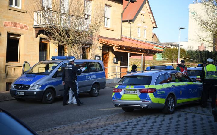 Police cars are seen at the site where a shooter, believed to have a personal motive, launched an assault on January 24, 2020 in the town of Rot am See in southwestern Germany.