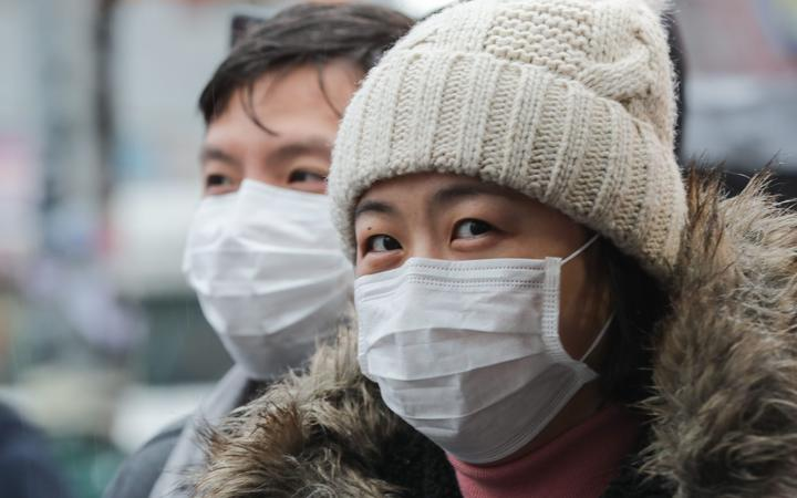 Flushing, Queens, New York, USA, January 25, 2020 - Mask People afraid of the coronavirus During the Queens Lunar New Year Parade in Flushing Along with Thousands of Chinese Immigrants and Parade Goers.
