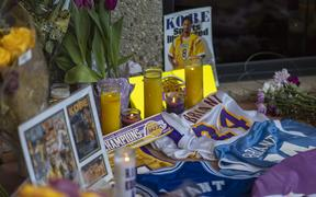 People mourn at a makeshift memorial at Mamba Sports Academy for former NBA great Kobe Bryant, who was killed in a helicopter crash while commuting to the academy on January 26, 2020 in Newbury Park, California.