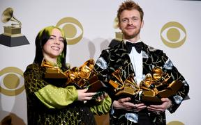 18-year-old pop star Billie Eilish and her brother and producer Finneas O'Connell with their combined Grammys haul.