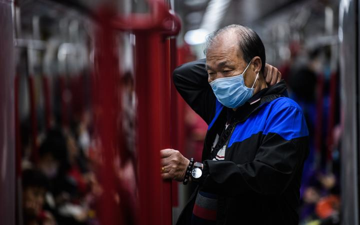 A man wears a face mask as he travels on the metro during a Lunar New Year holiday in Hong Kong on January 27, 2020.