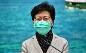 Hong Kong Chief Executive Carrie Lam announces travel restrictions.