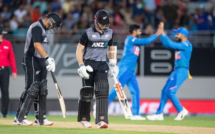 NZ captain Kane Williamson walks off after being caught during the Twenty/20 cricket international between India and New Zealand in Auckland.