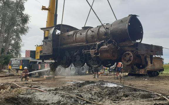 The V class locomotive is hoisted from the river at last.