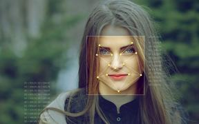 Recognition of a female face by layering a mesh and the calculation of the personal data by the software.