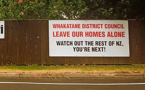 A small pocket of residents are still strongly opposing the Whakatane District Council's managed retreat process which would see residents forced to leave their homes