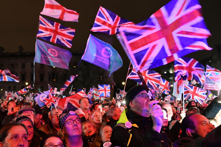 Brexit supporters wave Union flags as they watch the big screen in Parliament Square, venue for the Leave Means Leave Brexit Celebration party in central London.