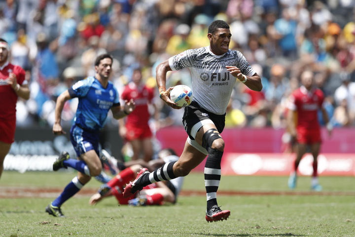 Fiji captain Meli Derenalagi races away from the Wales defence.