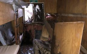 A DOC hut in Fiordland was almost wiped out by a slip caused by heavy rain in the area.