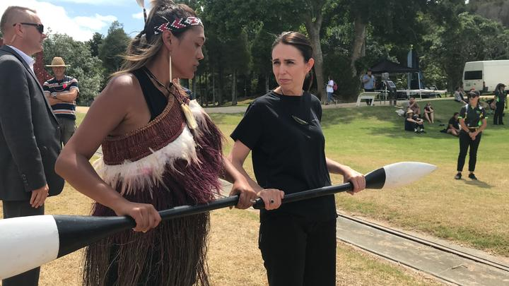 Prime Minister Jacinda Ardern takes instruction for paddling in preparation for boarding a waka hourua at Waitangi.