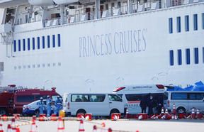 Passenger patients on board the Princess Diamond,  who have tested positive for the novel coronavirus are carried to an ambulance at the Yokohama port.