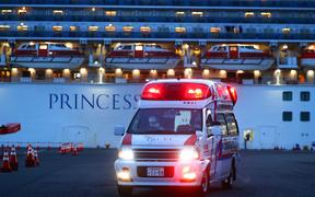 Patients who are on board the Princess Diamond and who have been found to test positive for the novel coronavirus are taken to an ambulance.