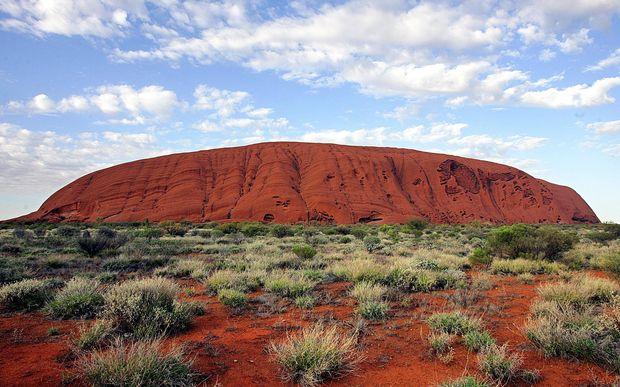 Climber's rush: Tourist rush at Australia's Uluru before climb ban