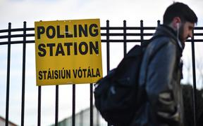 A man walks past a Polling Station in Dublin, Ireland on February 8, 2020, as voting gets under way in the Irish General election.