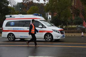 An ambulance carrying coronavirus patients arrives at a hospital in Wuhan, Feb 8 2020.
