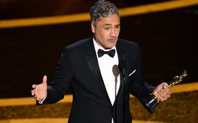 HOLLYWOOD, CALIFORNIA - FEBRUARY 09: Taika Waititi accepts the Writing - Adapted Screenplay - award for 'Jojo Rabbit' onstage during the 92nd Annual Academy Awards at Dolby Theatre on February 09, 2020 in Hollywood, California.   Kevin Winter/Getty Images/AFP