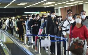 Tourists wear masks at Don Mueang Airport, in Bangkok, Thailand, 07 February 2020.