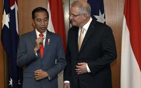 Indonesia's President Joko Widodo (L) and Australia's Prime Minister Scott Morrison (R) speak during a signing ceremony at Parliament House in Canberra on February 10, 2020.