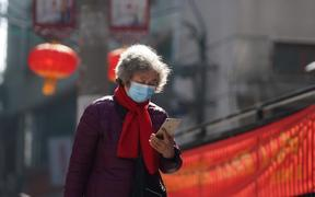 A resident checks information on her phone in Wuchang District of Wuhan, the epicenter of the novel coronavirus outbreak.
