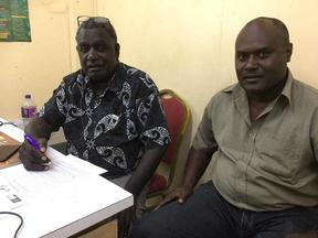 Bougainville's electoral commissioner George Manu and acting election manager George Kenatsi (February 2020)