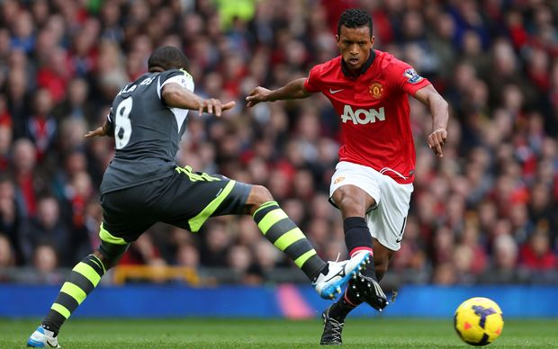 The Portugese footballer Nani playing for Manchester United.