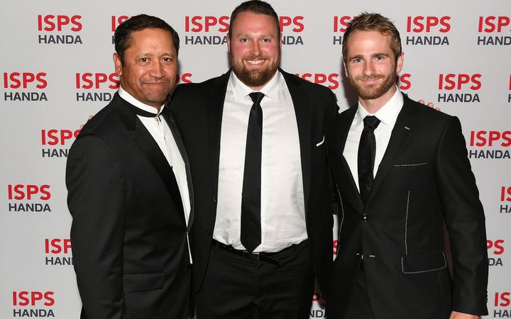Golfer Michael Campbell, shot putter Tom Walsh and Black Caps captain Kane Williamson share a moment at the Halberg Awards at Spark Arena in Auckland. Photo:PHOTOSPORT