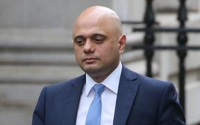Britain's Chancellor of the Exchequer Sajid Javid walks at Downing Street, London, 13 February.