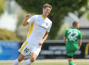 Reid Drake celebrates scoring a goal for Eastern Suburbs against Canterbury United.