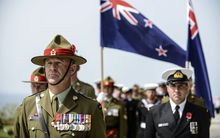 Australian and New Zealand soldiers take stand during the ceremony celebrating the 99th anniversary of the Anzac Day in Turkey on April 24, 2014.