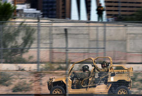 Members of the US Border Patrol tactical group hold a crowd control drill along the Rio Grande in El Paso, Texas.