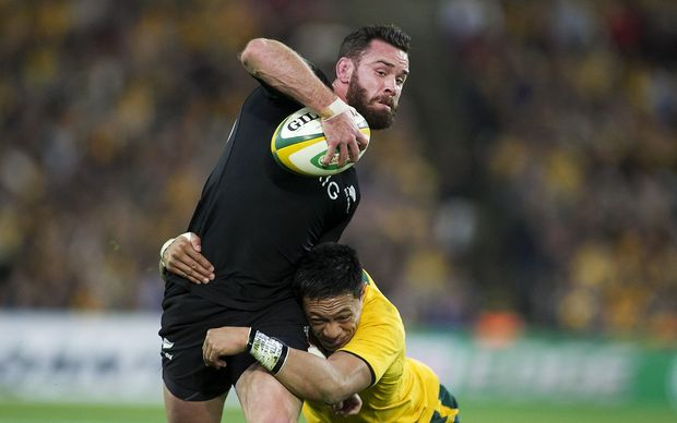 Ryan Crotty is tackled by Australia's Israel Folau in 2013.