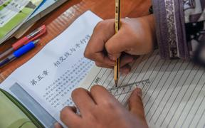 A student does homework at home in Nanchang city, east China's Jiangxi province, 11 February 2020.