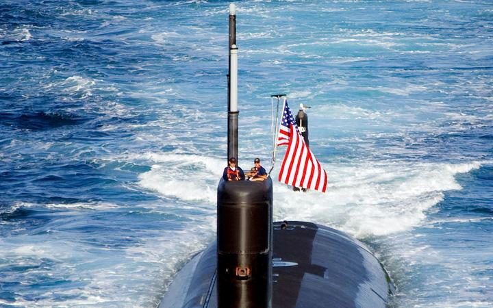The Los Angeles-class attack submarine USS Tuscon (SSN 770) transits the East Sea while leading a 13-ship formation.